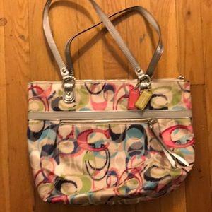 Coach shoulder bag. shiny fabric/ leather handles